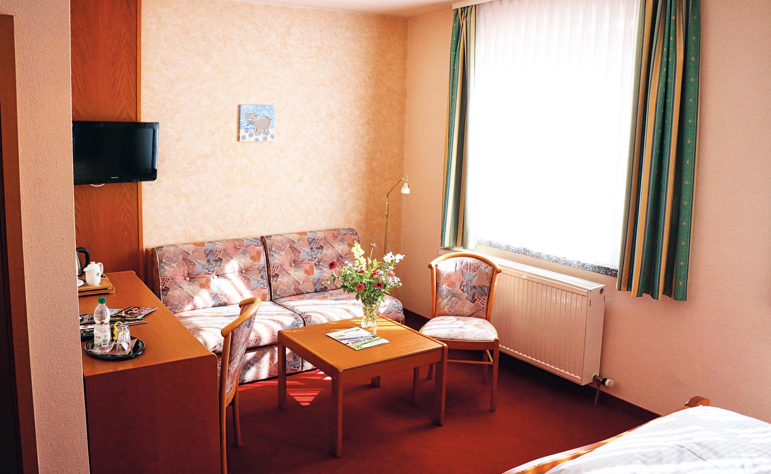 Doppelzimmer Sitzgruppe im Trakehnerhof